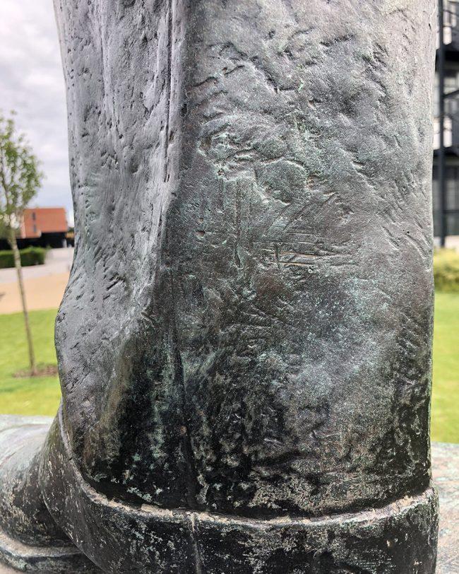Bronze statue damage - after