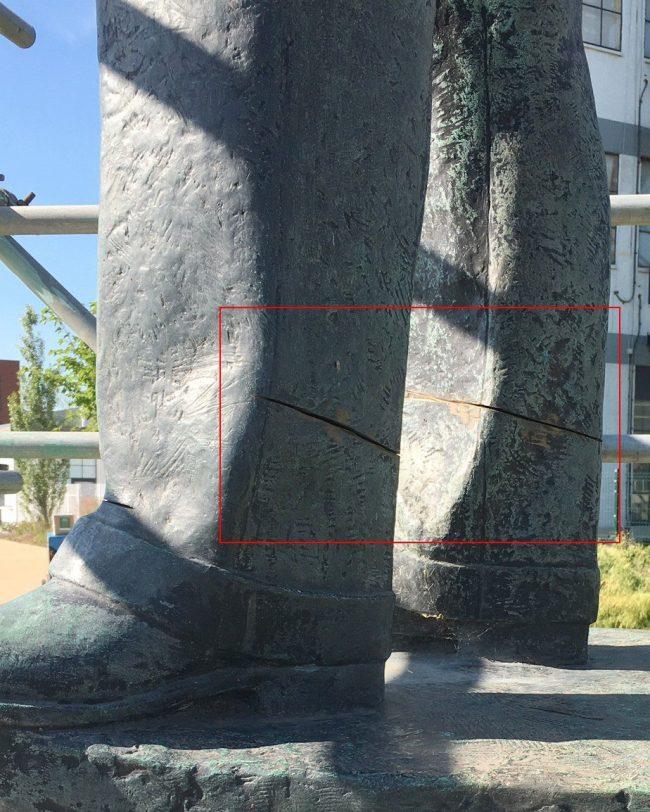 Bronze statue damage - before